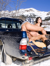 Double penetrating a brunette girl on a truck at the snow