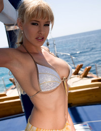 Blonde model with big boobs fucking on a boat with this guy