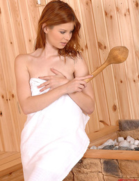 Cute redhead Judy getting jiggy in the hot sauna for us!