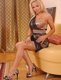 Beautiful blonde babe Jenna Lovely spreading pussy on sofa