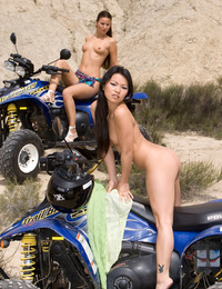 Asian and European babes sharing a big cock in the desert
